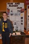 DE Student in front of his exhibit 2